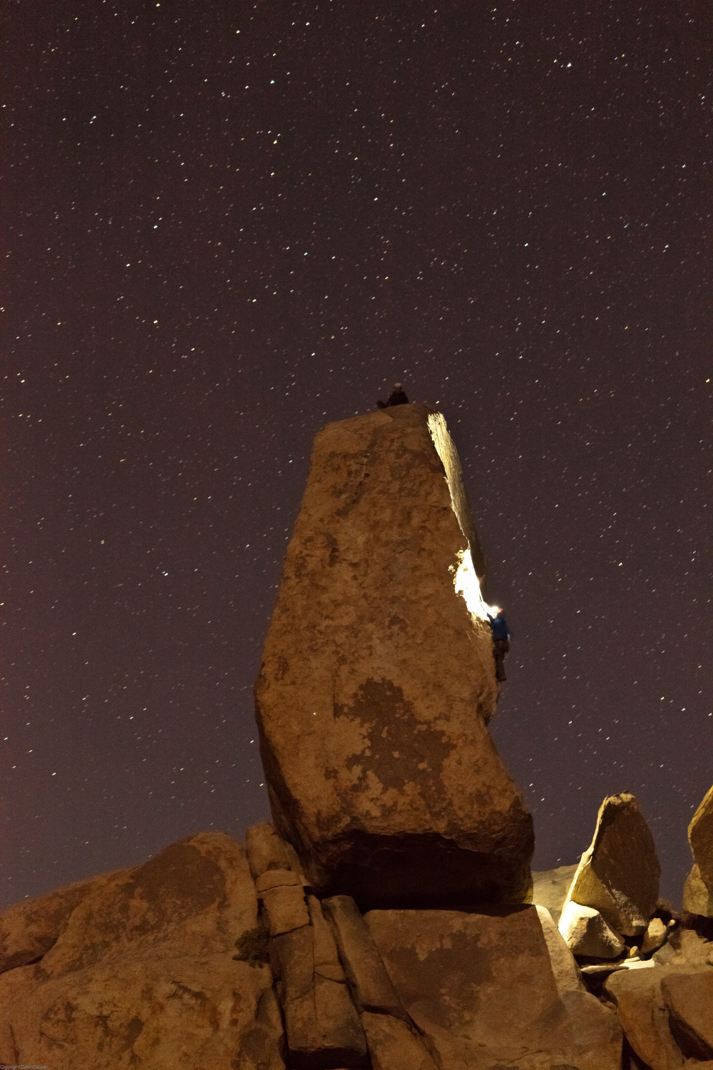 Climbers on a nighttime ascent  of the Headstone, Joshua Tree NP
