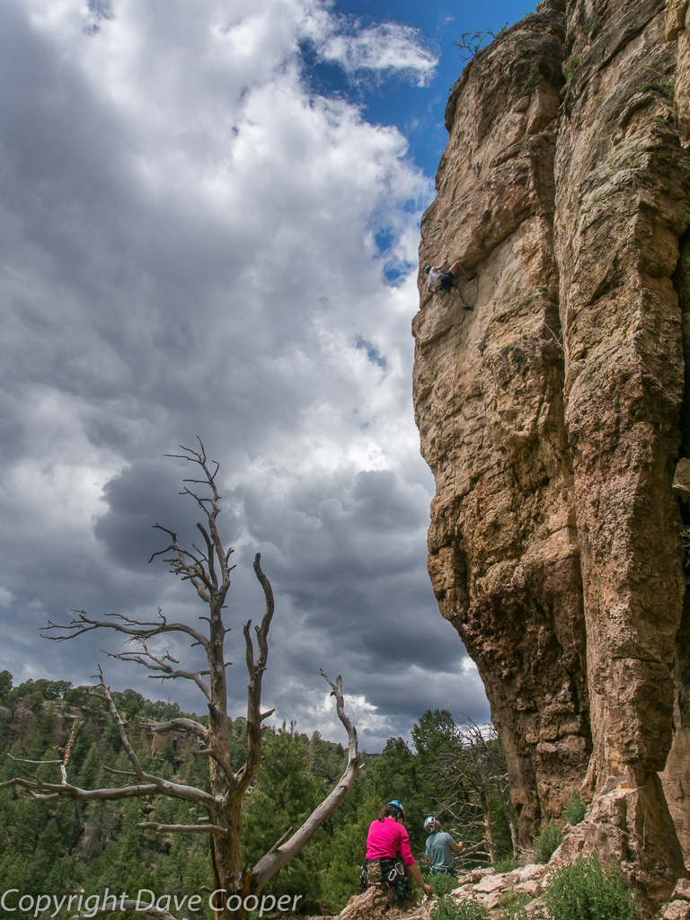 Stormclouds gathering above climber at Shelf Road, Colorado