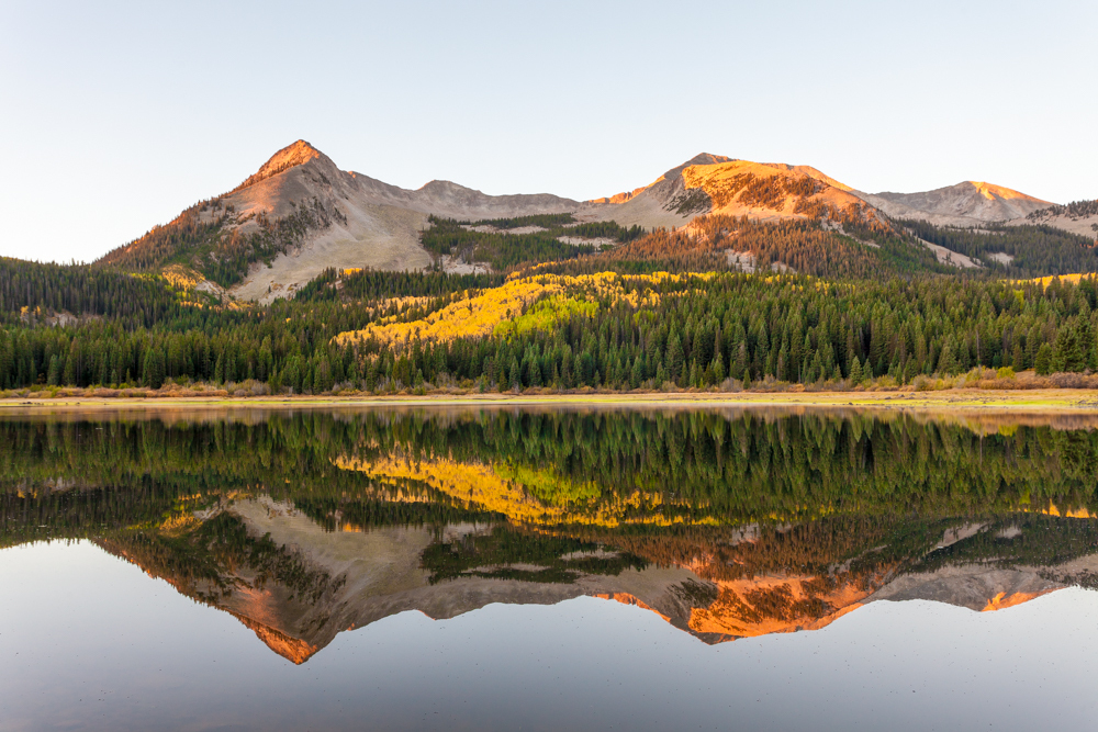 East Beckwith Mountain reflected in the waters of Lost Lake Slough sunrise fall color
