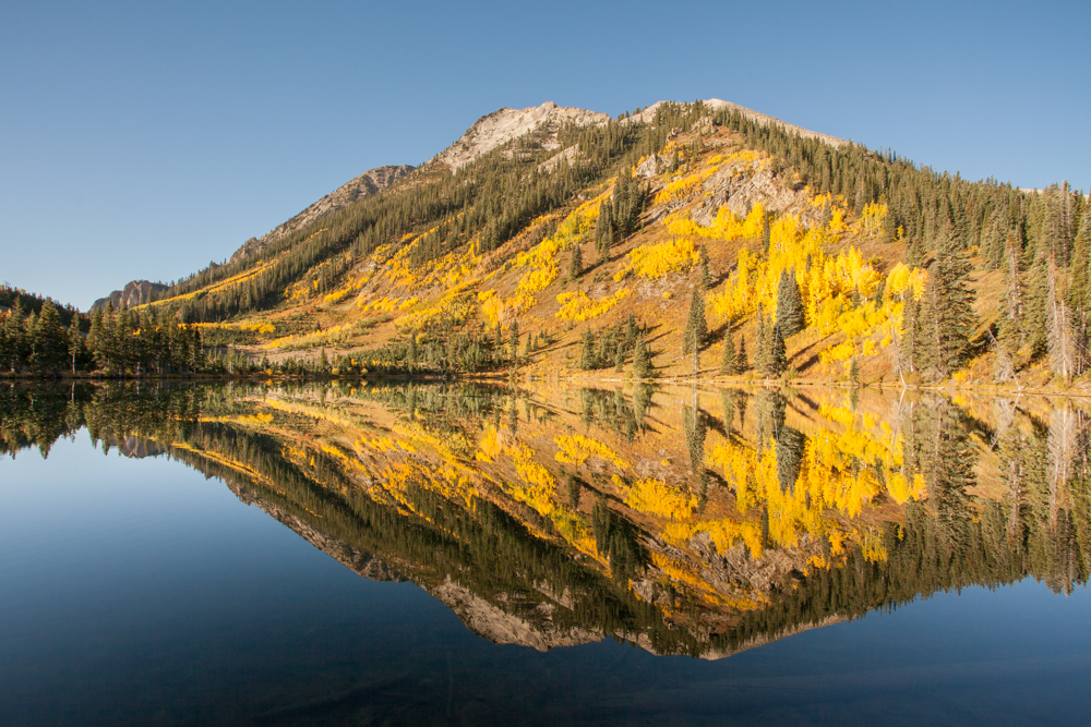 East Beckwith Mountain reflected in the waters of Dollar Lake sunrise reflection fall color
