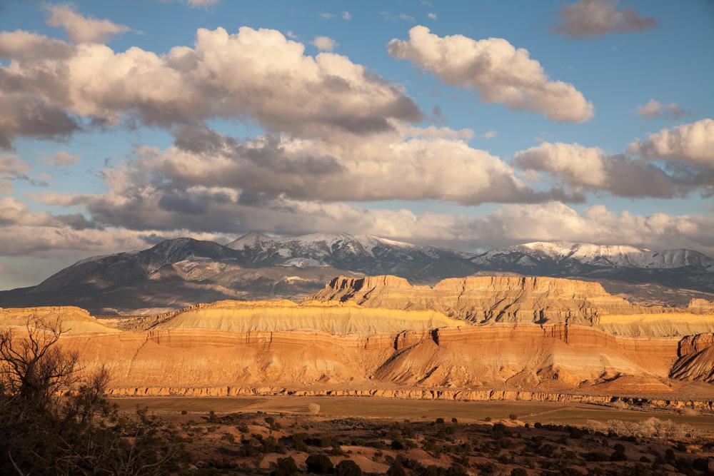 Sun setting over the Henry Mountains, Utah desert sandstone formations