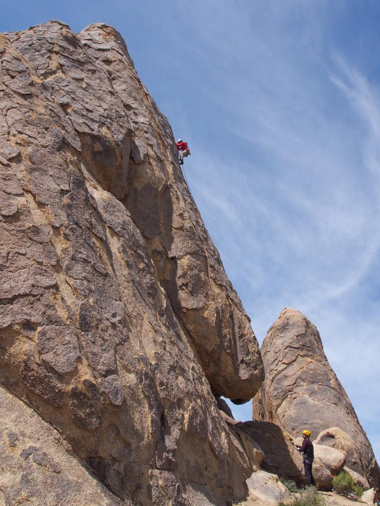 Rock Climber climbing Hillbilly Rock, Alabama Hills